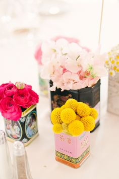 Bright flowers + vintage tins.