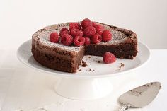 Fresh raspberries and powdered sugar are better than icing on this deep, rich Flourless Chocolate Cake.