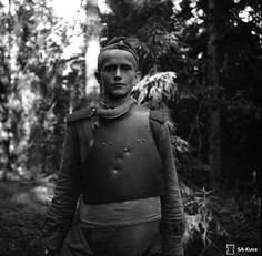"""Portrait of a young Soviet POW in a steel breastplate SN-42, made of 2mm steel (.08"""") and weighing 3.5 kg (7.7 lbs), captured by Finnish troops during the Finnish-Soviet Continuation War. A testament to the breastplate's effectiveness, the young soldier had been shot three times in the chest and left unharmed. Near Syskyjärvi, Karelia, Finland (now, Syuskyuyarvi, Republic of Karelia, Russia.) 15 July 1944. Image taken by Esko Töyri."""