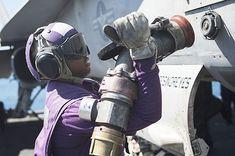 Aviation Boatswain's Mate (Fuels) Airman Recruit Joneca Gumbs fuels an F/A-18E Super Hornet on the flight deck of aircraft carrier USS George Washington (CVN 73).