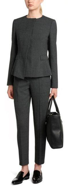 Hugo Boss grey suit with BOSS 'Jadela' Stretch Virgin Wool Asymmetrical Blazer and BOSS 'Tiluna' Stretch Virgin Wool Dress Pants. Queen Letizia of Spain attends the forum against cancer 'Por un enfoque integral' at  Espacio Fundacion Telefonica on February 2, 2017 in Madrid, Spain.