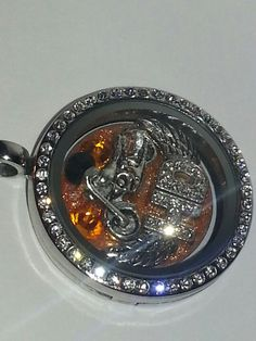 Custom Harley Locket Necklace. Great Prices on Memory Lockets and charms. LOCKET pictured only $46!  (Other places cost is $40 just for charms!)  Great customized gifts! email charms4lockets@gmail.com teams, customized name plates, charms, lockets and bracekets. Let me design one for you!