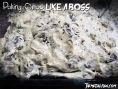 Poking Oreos like a Boss - oreo poke cake with cream cheese and vanilla frosting
