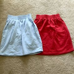 "American Apparel | Bundle Mini Skirts Both used once! Cinched waist and side pockets.  LIGHT BLUE - SIZE MEDIUM RED- SIZE LARGE Can sell separately for $10   { NO TRADES - NO TRY ONS- NO ""LOWEST""} Rude comments and lowballs will be ignored and blocked. American Apparel Skirts Mini"