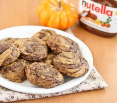 """Pumpkin Nutella Swirl Cookies from Kirbie's Cravings -- A San Diego food blog.  From site pinned:  """"Swirling in the Nutella made these soft and fluffy cookies even better. These cookies are like little bites of pumpkin cake."""""""