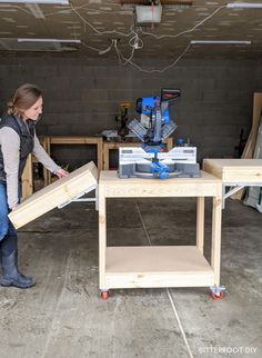 Build this DIY mobile miter saw stand with collapsible wings with free plans from Bitterroot DIY. Build this DIY mobile miter saw stand with collapsible wings with free plans from Bitterroot DIY. Workbench Plans Diy, Woodworking Ideas Table, Mobile Workbench, Folding Workbench, Easy Woodworking Projects, Woodworking Shop, Miter Saw Stand Plans, Diy Miter Saw Stand, Mitre Saw Stand