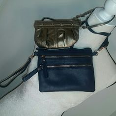 Wristlet and Crossbody Bundle Brand new, never used. Wristlet and Crossbody bundle. The Navy crossbody can be worn as a crossbody or wristlet. It has a wrist attachment and crossbody. The zippers are a rose colored. The bronzed wristlet has silver embellishments. Can go lower thru P or Merc   Tags: coach, tory Burch, michael kors, macys (just for visibility) Bags Crossbody Bags
