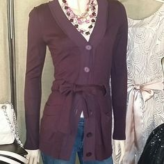 "Ann Taylor LOFT LS Vneck Cardigan Size Small Ann Taylor LOFT Long Sleeve V-neck Burgundy Wine Color Cardigan with Six (6) large color matching button and tie front closure. Also matching color is a 2"" Nylon fabric that accentuates the collar and the placket. Two open front pockets. Ribbed Sleeve and Hem ends.   41% Rayon * 27% Cotton * 16% Nylon * 16% Wool (Machine Washable)  Approx 29"" Top of Shoulder to Hem End  Approx 21"" Armpit to Hem End  Approx 27"" Top of Shoulder to Sleeve End  Approx…"
