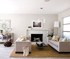 white painted wooden mantel, waterfall shoulder to ground, marble surround, fireplace