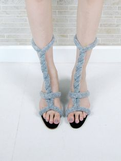 OK, who's going to be first with a pattern?  Knit, stuffed i-cord sandals you can wear different ways!