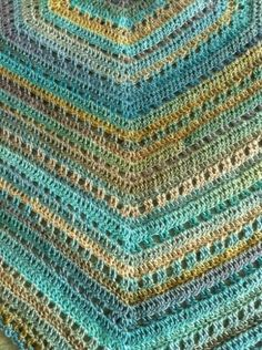 """I love this pattern!  It's called Eva's Shawl and works up beautifully.  I made two, one in aqua colors and the other in beiges and browns.  I used Red Heart Unforgettable yarn, the colors are a """"long"""" ombre, and it's oh so soft.  It's a #3 weight category and I used a size G hook.Here's the pattern:EvaShelley"""