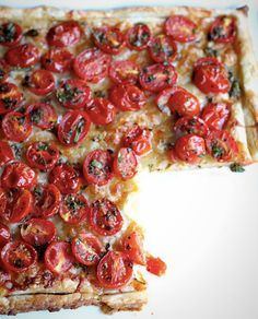Use puff pastry and cherry tomatoes to make this tart.