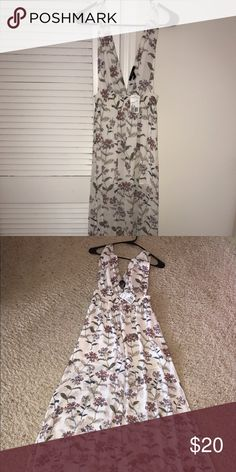 Forever 21 Long Dress Gorgeous white Floral dress size S...Gorgeous piece...NWT...Never worn...Paid $27... Forever 21 Dresses Maxi