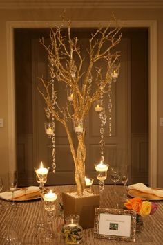 I like the floating candles in wine glasses and sparkly branches... Great bridal shower idea.