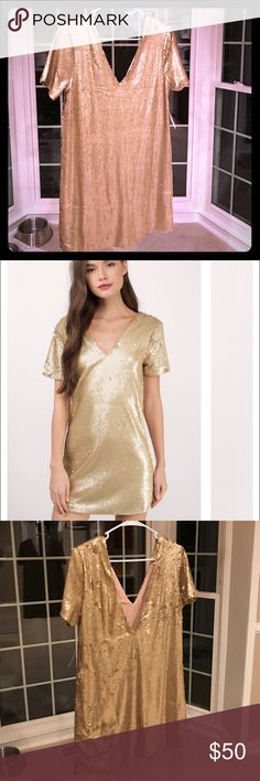 NYE Sequin Gold Dress Just bought this dress off of Tobi for New Years! Brand new, never been worn and still has the tags on it. It's a size large, isn't skin tight and has a deeper back. Tobi Dresses Mini