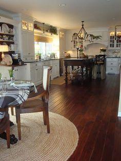 kitchen, white cabinets, dark island, wood floors