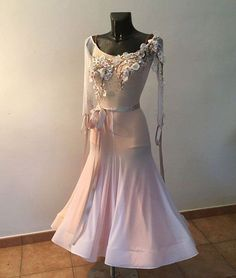 Ethereal pale pink Ballroom Dress with delicate floral decorations on the bodice. Classic trumpet silhouette.