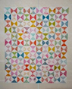 Red Pepper Quilts: Hour Glass Block Tutorial...The Hour Glass Block is really just an extension of the Half Square Triangle block in terms of piecing.  What follows is a short tutorial showing you how I have pieced the Hour Glass Blocks in this quilt top.