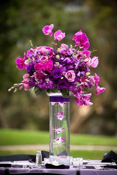Fuchsia and purple tall centerpiece