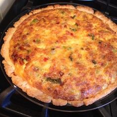 """""""You can add other meats or veggies to suite your taste, and this quiche can be baked with or without pie shells.  My whole family (ages 65 to 1) love this quiche! Sometimes I add a small package of chopped ham to the recipe."""""""