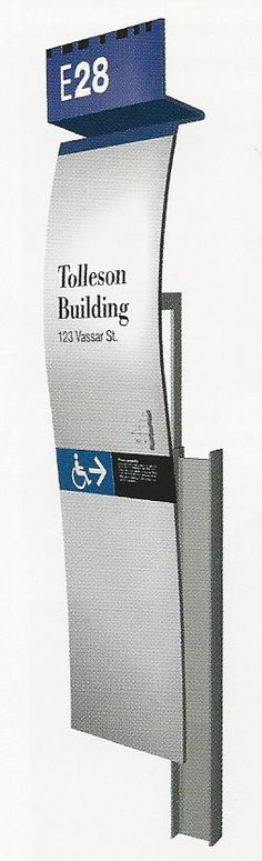 Curved Planes. Identification and Directional Sign. The Wayfinding Handbook by David Gibson. Marks the entrance of a building but also offers directional signage to the handicap ramp.
