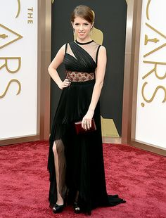 Anna Kendrick in black J.Mendel fall/winter red carpet gown featuring a high slit.