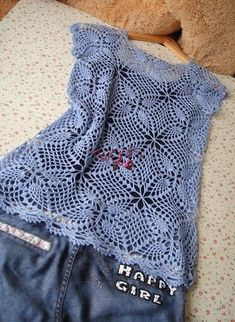 An openwork waistcoat crocheted.