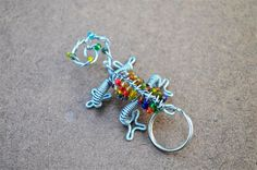 Beaded reptile keychain African wire and bead art by akwaabaAfrica, $5.00 Everyday Items, Beads And Wire, Wire Art, Bead Art, African, Trending Outfits, Unique Jewelry, Handmade Gifts, Diy