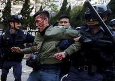 Hong Kong riot police fire warning shots in bloody street clashes | Reuters