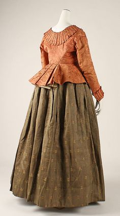 Back view, 2-piece ensemble of jacket and skirt, probably Austria, 18th century. Jacket: orange silk damask with a floral pattern; skirt: brown-green striped silk with floral sprays.