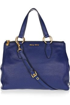 MIU MIU  Textured-leather tote  $1,395  Editor's notes  Details    Miu Miu's textured-leather tote is at the top of our wish list this season. The cool blue hue will perfectly complement a bold color palette - wear it with statement pants and metallic pumps for an eye-catching look.