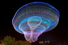 Janet Echelman is an American artist who creates fluid moving sculptures out of nets. She was first inspired to use nets while in Mahaballipuram. , India learning netting techniques from local fishermen.  Most of her sculptures  have both machine and hand-woven netting  from weather and UV-resistant fibers.