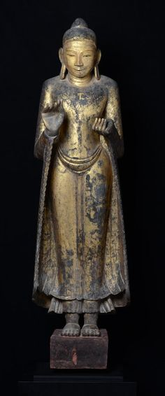 14th C., Pagan,  Rare Burmese wooden Buddha standing on a base, traces of original lacquer and gilding remaining.
