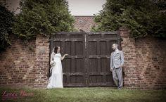 I love the contrast of formal wedding attire against rustic architecture!  | Lynda Berry Photography  #Wedding #Rustic #WeddingPhotography #WeddingPhotos #Bride #BrideandGroom #GrayTuxedo #Outdoors