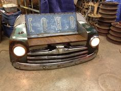 Ford bench with front bumper and grill. Working lights and cup holders.