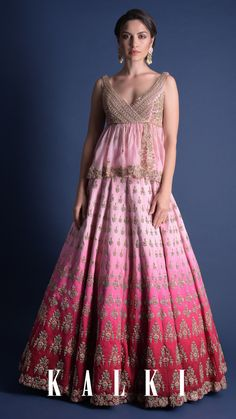 #ThePowerOfPeplum First things first, you are going to be the center of the attraction in the attire. Consider this as the unique take on the pink ombre lehenga with an intricately hand-constructed organza peplum top. Spelling royalty and class in the most subtle way, this peplum lehenga is going straight into your Mehendi checklist! 🌸