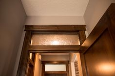 Interior Products | beautiful, fixed, rain glass transom window above interior door with topper | Bayer Built Woodworks, Inc.