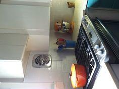 Subway Tile Kitchen Backsplash. Vintage Metal Kitchen Cabinets And Exhaust  Fan.
