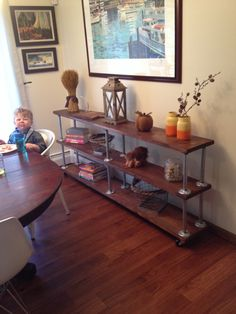 Built this wood and plumbing pipe shelf/buffet. I used new wood but roughed it up with tools, stained and poly. So proud of this piece