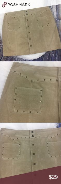 """Route 66 Tan Brown Leather Brass Rivet Skirt Route 66 mini skirt • Brown / Tan 100% leather • Fully lined • Brass Snaps all the way up the front • 2 front pockets with matching brass rivet detail • Great Condition-some scratches on the leather from being hung on a clip hanger and folded, see photos for detail • Women's size 14 • Measurements : Waist-36"""", Length-17.5"""", Hip-22"""" Route 66 Skirts Mini"""