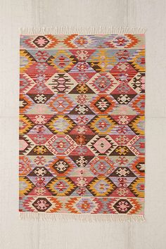 Magical Thinking Maimana Woven Rug. Product Sku: 34893446; Color Code: 066 Low-profile throw rug from Magical Thinking woven in an allover modern geo pattern inspired by classic designs. In vintage-washed and faded colors we love, this rug is available only at Urban Outfitters.