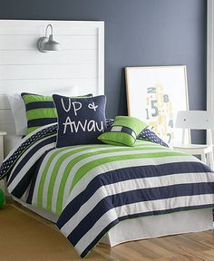 Green and Navy bedding. I also really like the headboard with the light.