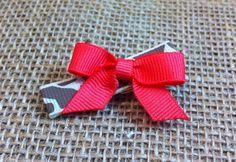 Tiny coral bow  on Etsy, $2.99