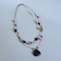 PURPLE AND PINK SILVER TONE ILLUSION NECKLACE Like new. Unknown Jewelry Necklaces