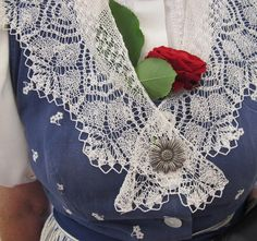 this one if typical of the Zurich Highlands (Zuercher Oberland) and is still worn on special occasions.  Highlights are the hand-made lace shawl, the silver flower broach and a fresh red rose.