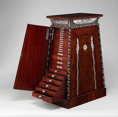 Coin Cabinet probably by Francois-Honore-Georges Jacob-Desmalter, mounts by Biennais, ca. 1809-1819, mahogany and applied/inlaid silver. Metropolitan Museum of Art.