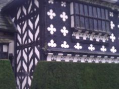 Quatrefoils on the outside of Little Moreton Hall, Cheshire. A Tudor Manor House.