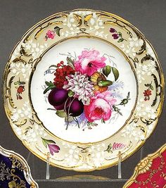 Coalport cabinet plate with a toffee coloured ground, gilt highlights and the centre painted with flowers
