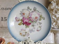 Here is a stunning vintage plate for your collection.    This plate is made out of porcelain with a white background and pretty band of faded