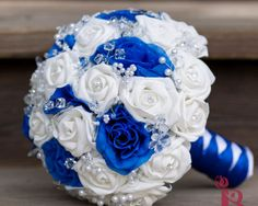 Aqua blue jeweled brooch bouquet with cream roses | The Bridal Flower